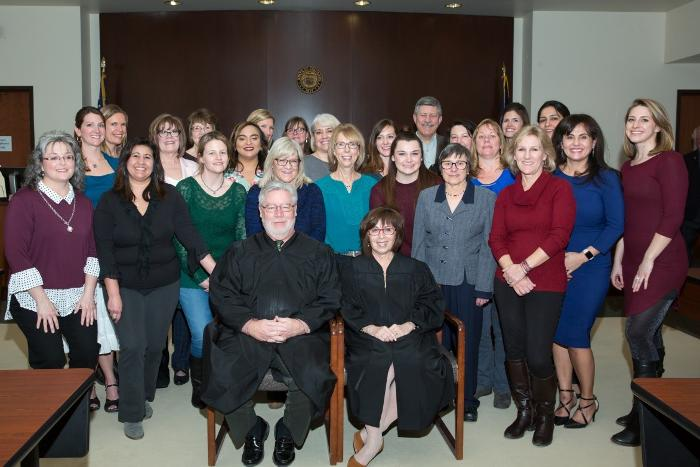 The 24 new CASA Volunteer Advocates are pictured behind (from left),  Magistrate Peter Stapp and Judge Katherine Delgado